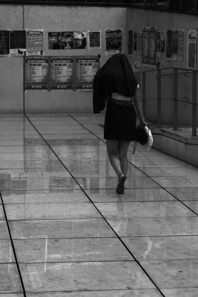 Walking away in the rain